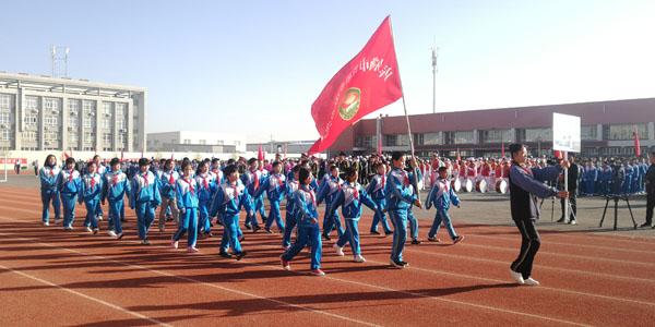 库尔勒市举办第三十六届中小学生田径运动会暨教职工趣味运动会